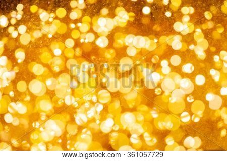 Christmas And Happy New Year On Blurred Gold Bokeh Banner Background.
