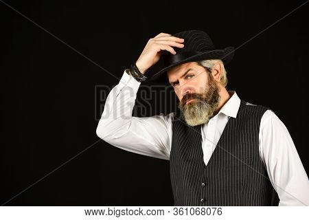 Man In Vintage Style Wide Brimmed Hat. Man With Retro Hat. Brutal Bearded Hipster In Suit Vest. Mafi
