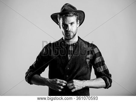 Cowboy Wearing Hat. Western Life. Man Unshaven Cowboy Beige Background. Unshaven Guy In Cowboy Hat.