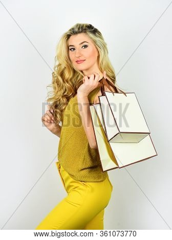 Sexy Blonde Carry Shopping Bags. Elegant Woman Shopaholic. Girl Shopper Hold Paperbag Package. Buy P