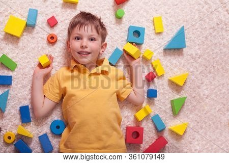 Funny Baby Boy Playing With A Constructor, The View From The Top, Flat Layout. Concept Of Childrens