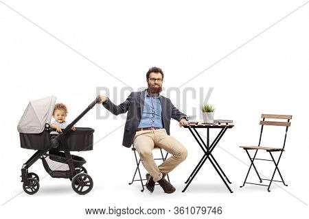 Father with a baby in a pushchair sitting in a cafe isolated on white background