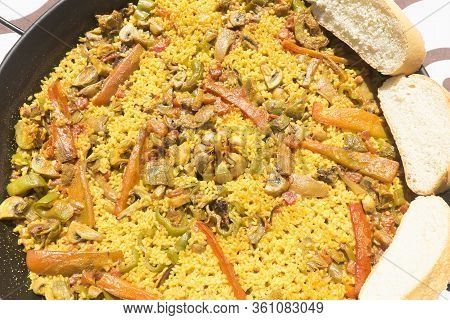 Vegetable Paella Made On Fire With Organic Ingredients.