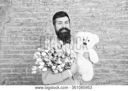 Happy Moments. Love Date. Happy International Holiday. Happy Bearded Man With Tulip Bouquet And Bear