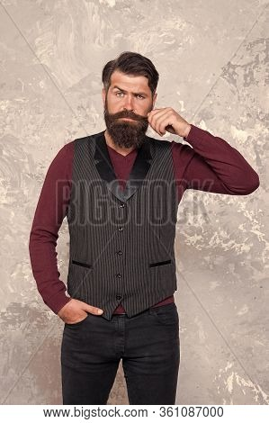 Loving His Style. Brutal Man Touch Mustache. Perceptions Of Male Beauty. Bearded Hipster With Shaved