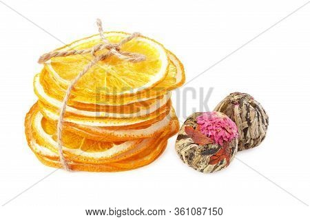 Green Bound Asian Tea Balls With Dried Slices Of Orange Isolated On White Background