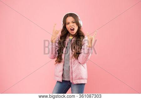 Rock Music Lover. Little Girl Wear Earphones Pink Background. Enjoy Sound. Sound Vibrations. Music A