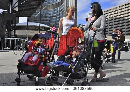 Toronto, Ontario/ Canada - 06-09-2009 :  Demonstrate On The Issue Of Daycare With Strollers