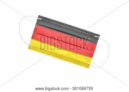 Medical Face Mask With Flag Of Germany Isolated On White Background. Germany Pandemic Concept. Attri