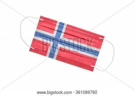 Medical Mask With Flag Of Norway Isolated On White Background. Pandemic Concept In Norway. Attribute