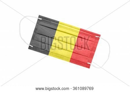 Medical Mask With The Flag Of Belgium Isolated On A White Background. Belgium Pandemic Concept. Attr
