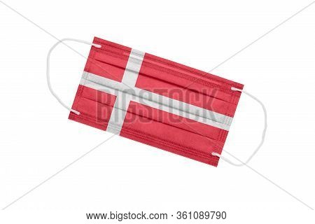 Medical Face Mask With Flag Of Denmark Isolated On A White Background. Denmark Pandemic Concept. Att
