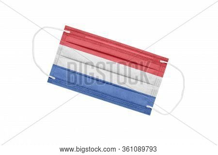 Medical Face Mask With Flag Of Netherlands Isolated On A White Background. Pandemic Concept In The N