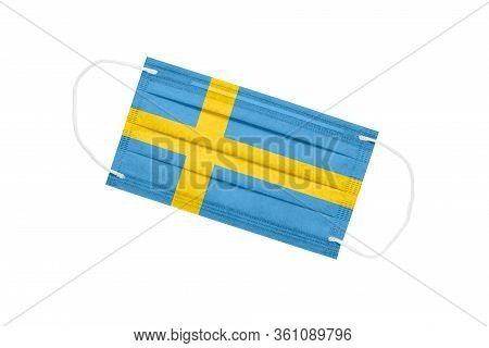 Medical Face Mask With Flag Of Sweden Isolated On White Background. Sweden Pandemic Concept. Attribu
