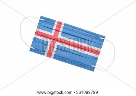 Medical Face Mask With Flag Of Iceland Isolated On A White Background. Pandemic Concept In Iceland.