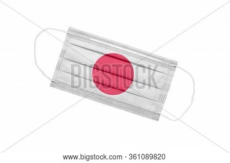 Medical Face Mask With Flag Of Japan Isolated On White Background. Pandemic Concept In Japan. Attrib