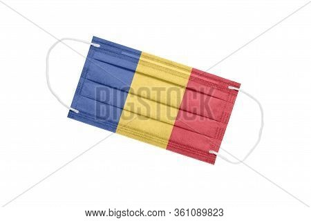 Medical Face Mask With Flag Of Romania Isolated On A White Background. Romania Pandemic Concept. Att