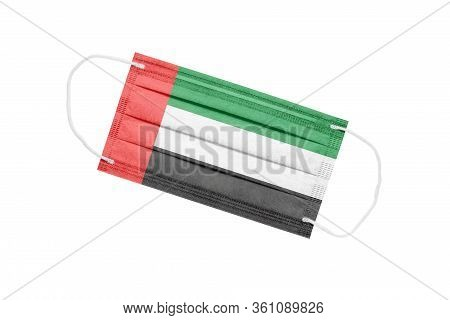 Medical Face Mask With Flag Of United Arab Emirates Isolated On White Background. Pandemic Concept I
