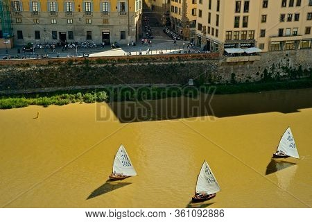 Florence, Italy - May 31, 2019: Three Sailboats, Seen From Above, Float Past On The Arno River In Th