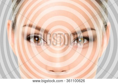Hypnosis spiral over Asian woman face of hypnotized girl portrait background.