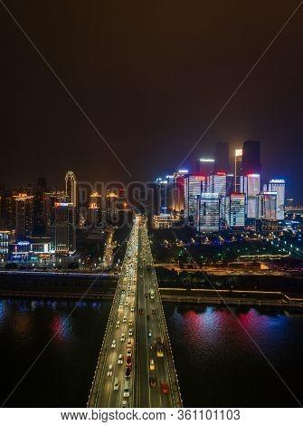Dec 22, 2019 - Chongqing, China: Aerial Night View Of Huanghuayuan Bridge To Jiang Bei District