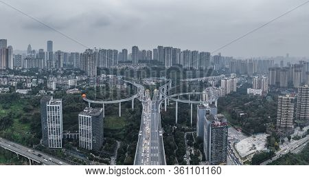 Dec 23, 2019 - Chongqing, China: Aerial Pano Drone Shot Of Caiyuanba Flyover With Traffic In Bleak M