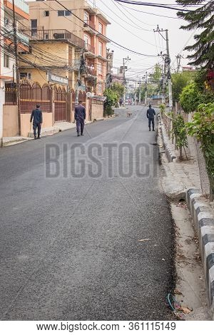 Kathmandu, Nepal - April 14, 2020: Police Patrol Empty Streets During Coronavirus Lockdown. Traffic