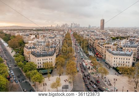 Paris, France - April 9, 2019: Panoramic View From Arc De Triomphe On Eiffel Tower And Avenue Des Ch