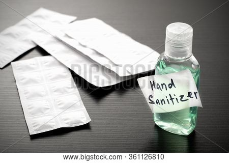Antibacterial Alcohol-containing Hand Sanitizer In A Plastic Bottle. Hand Sanitizer In Green Color O