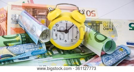 Time Is Money. European Estimate Of Your Time. Evro, Alarm Clock, And European Paper Money, On A Whi