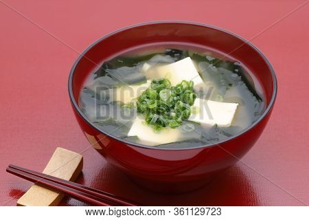 Japanese Food, Miso Soup Of Tofu And Seaweed Wakame In A Bowl With Chopsticks