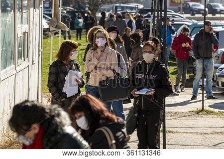 Sofia, Bulgaria - April 8, 2020: People Wearing Face Masks In An Attempt To Prevent The Spread Of Co