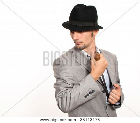 Young Businessman Holding A Machete