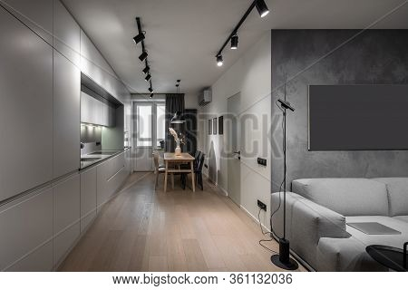 Interior Of Illuminated Modern Flat With Kitchen Zone
