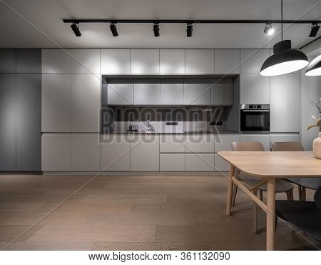 Interior Of Illuminated Modern Kitchen With Parquet Floor