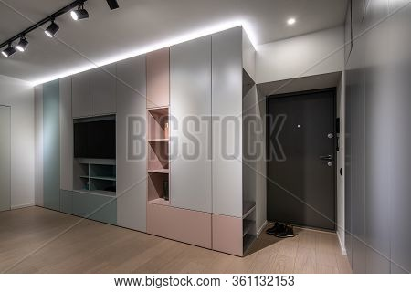 Interior Of Illuminated Modern Flat With Multicolored Cabinets