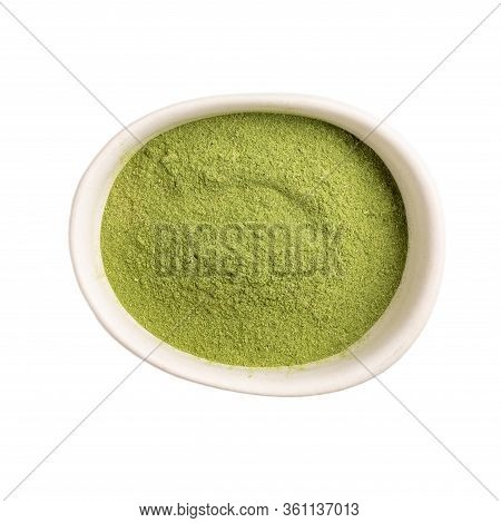 Organic Wheatgrass Powder In White Bowl Isolated On White Background. Top View, Close-up.  Green Sup