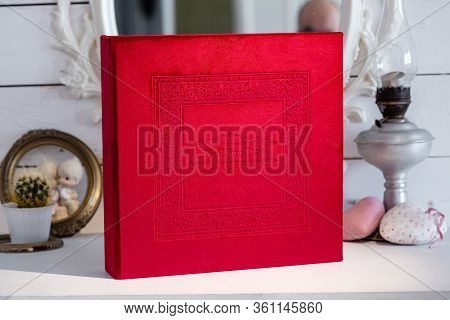 Photo Album With A Box On A Wooden Background. Photo Book With Embossing. Photobook With A Gift Box