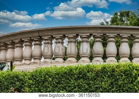 A Curved Cement Balustrade In A Public Park