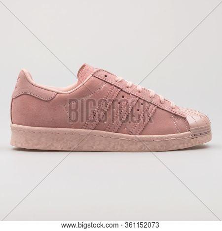 Vienna, Austria - August 22, 2017: Adidas Superstar 80s Metal Toe Pink Sneaker On White Background.