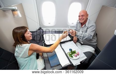 Johannesburg, South Africa - February 06, 2014: Middle Aged Couple Toasting With A Glass Of Champaig