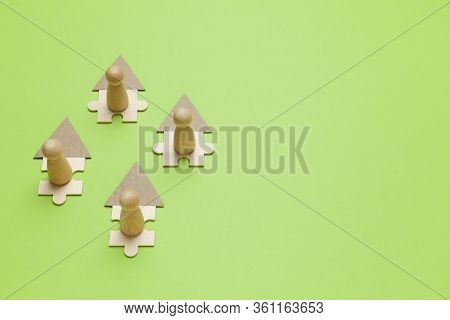 Wooden Figures Working Online In House On Green Background. Freelance Workplace At Home, Teleworking