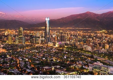 Panoramic View At Dusk Of Santiago De Chile With The Andes Mountain Range In The Back