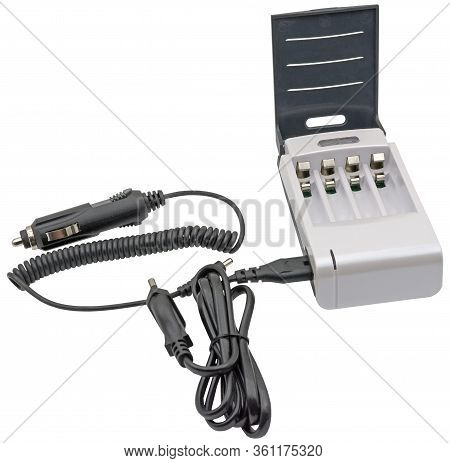 Charger For Charging Of Aa And Aaa Rechargeable Batteries On A White Background