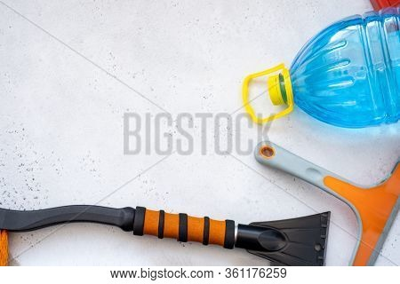 Hand Cleaning A Car Windshield With Window Cleaner Wiper. Washing Car Front Windshield Glass.