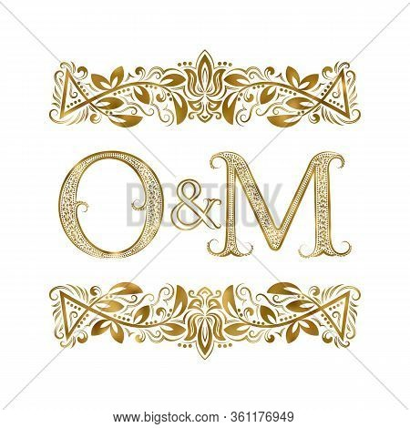 O And M Vintage Initials Logo Symbol. The Letters Are Surrounded By Ornamental Elements. Wedding Or