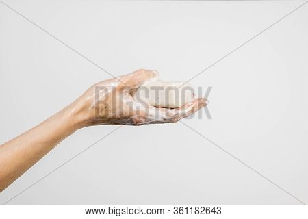 Close Up Of Caucasian Woman Washing Her Hands With Bubbly Soap Bar Isolated On White Background. Dem