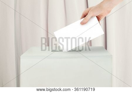Vote Concept. Voter Hand Holding Ballot Paper For Election Vote On Polling Station