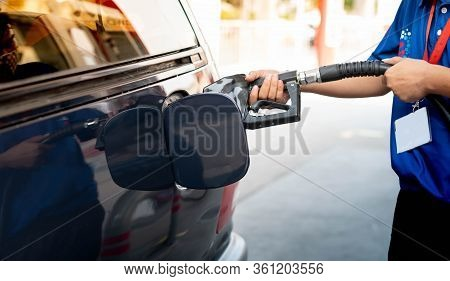 Male Hand Fill Up Petrol Tank Gasoline Fuel Petrol In Car Being Filled With Fuel At Gas Petrol Stati