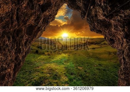 Sunset On The Mountain From A Cave